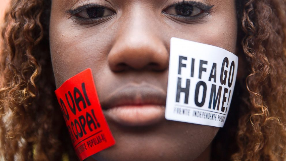 "PHOTO: A woman protests with signs pasted on her face that read ""FIFA Go Home"" and ""Will not have a Cup"" during a march against the World Cup 2014 at the Copacabana beach, in Rio de Janeiro, June 12, 2014."