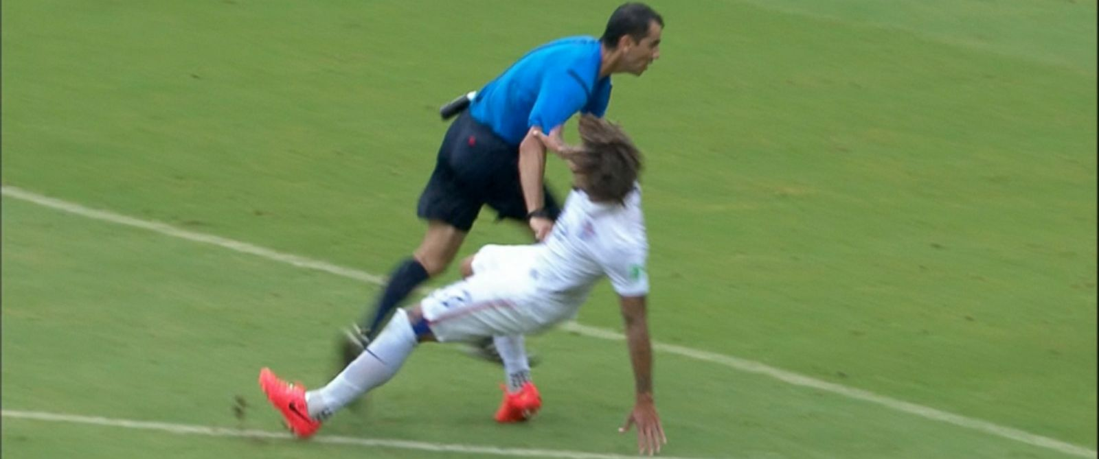 PHOTO: USA player Jermaine Jones collides with the ref during the first half of the USA vs. Germany match of the 2014 FIFA World Cup, June 26, 2014, in Brazil.