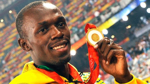 PHOTO: Usain Bolt, holding the gold medal that he won in the Men's 4x100m Relay Final at the Beijing 2008 Olympics.