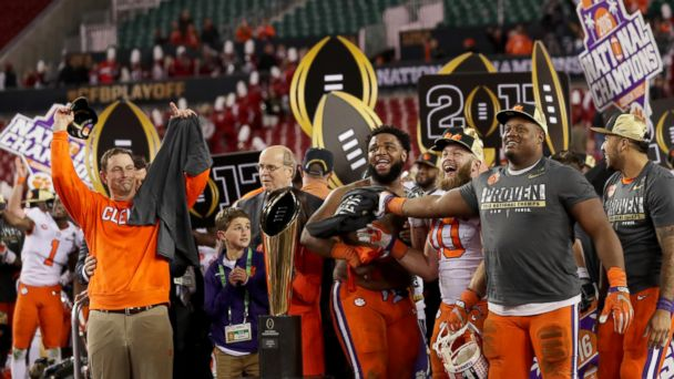 PHOTO: Clemson head coach Dabo Swinney, left, celebrates with his team after defeating the Alabama Crimson Tide 35-31 to win the 2017 College Football Playoff National Championship Game at Raymond James Stadium on Jan. 9, 2017 in Tampa, Florida.