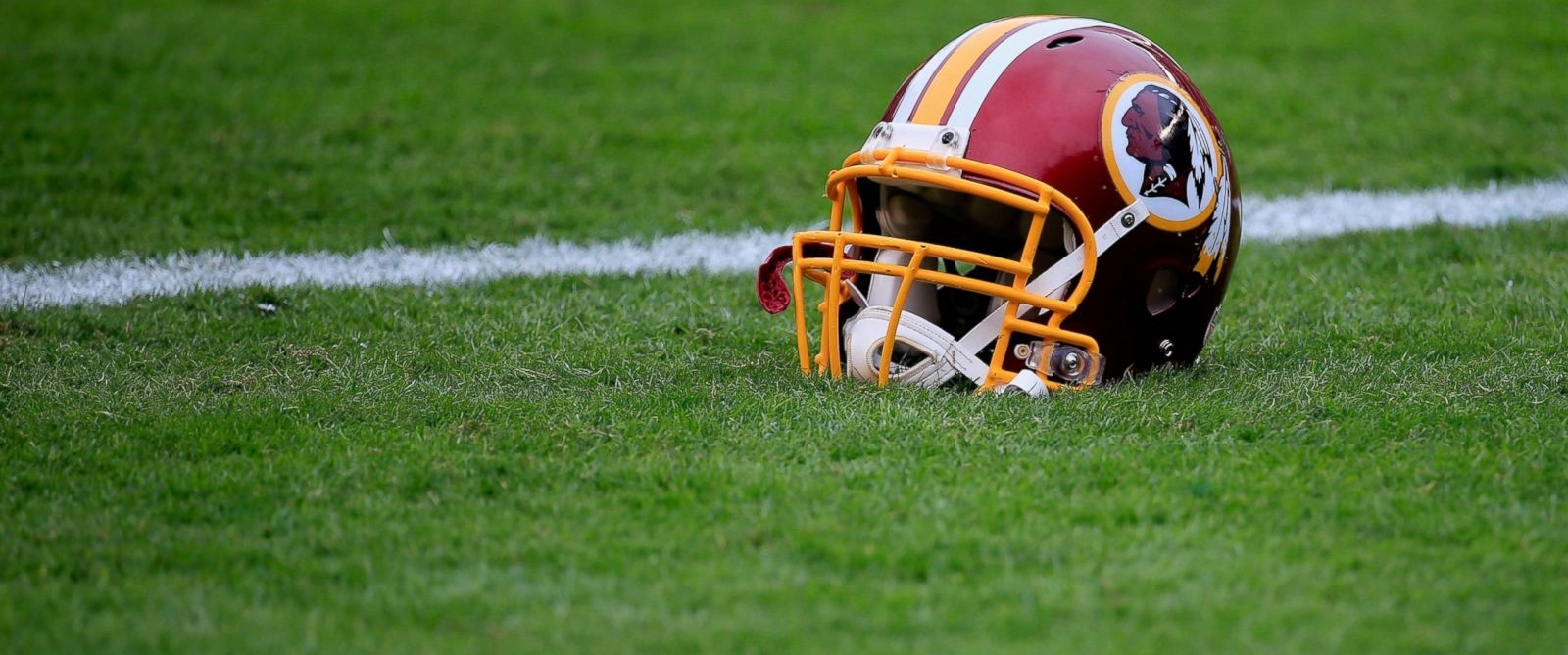 PHOTO: A Washington Redskins helmet is seen on the field before the game against the Philadelphia Eagles at Lincoln Financial Field, Sept. 21, 2014, in Philadelphia.