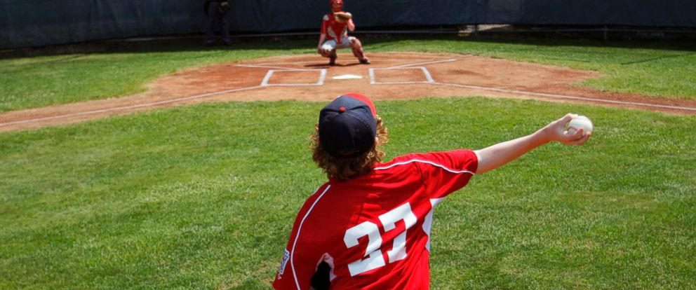 PHOTO: A Little Leaguer fires a pitch during the opening day of the Little League Baseball state tournament in Biddeford, Maine, July 18, 2014.