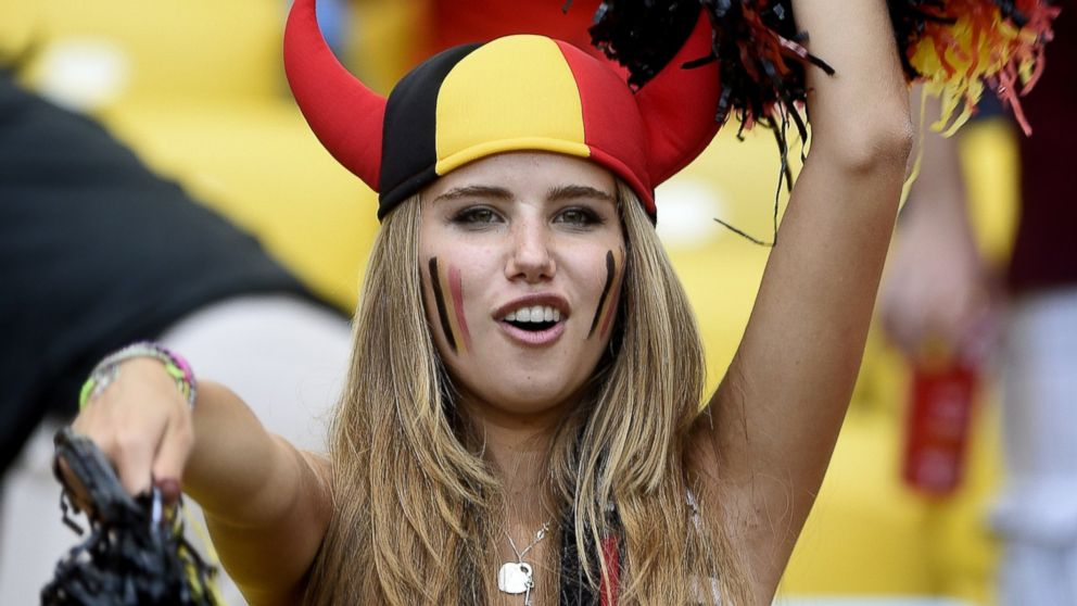PHOTO: Axelle Despiegelaere, a Belgium fan poses as she waits for the start of the Group H football match between Belgium and Russia at the Maracana Stadium in Rio de Janeiro during the 2014 FIFA World Cup on June 22, 2014.