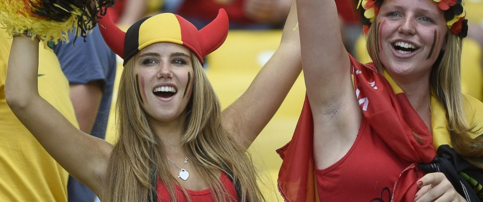 PHOTO: Axelle Despiegelaere, a Belgium supporter cheers with her friend as they wait for the start of the Group H football match between Belgium and Russia at the Maracana Stadium in Rio de Janeiro during the 2014 FIFA World Cup on June 22, 2014.