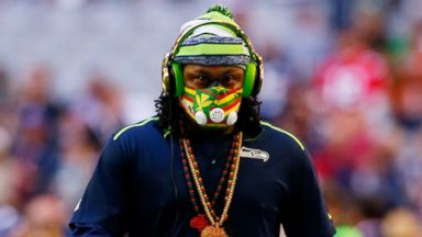PHOTO: Marshawn Lynch of the Seattle Seahawks walks on the field prior to Super Bowl XLIX at University of Phoenix Stadium, Feb. 1, 2015 in Glendale, Ariz.