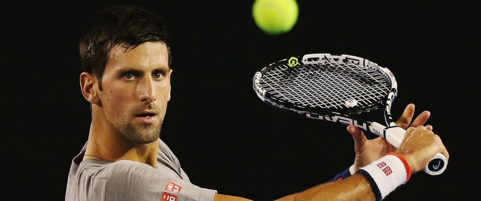 PHOTO:Novak Djokovic of Serbia hits a backhand volley during a practice session ahead of the 2016 Australian Open at Melbourne Park, January 14, 2016 in Melbourne, Australia.