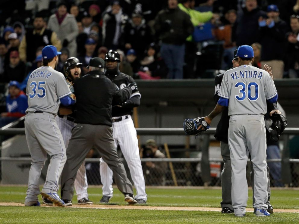 PHOTO: Yordano Ventura of the Kansas City Royals talks to umpire Sam Holbrook Adam Eaton of the Chicago White Sox is restrained during the seventh inning on April 23, 2015 at U.S. Cellular Field in Chicago, Illinois.
