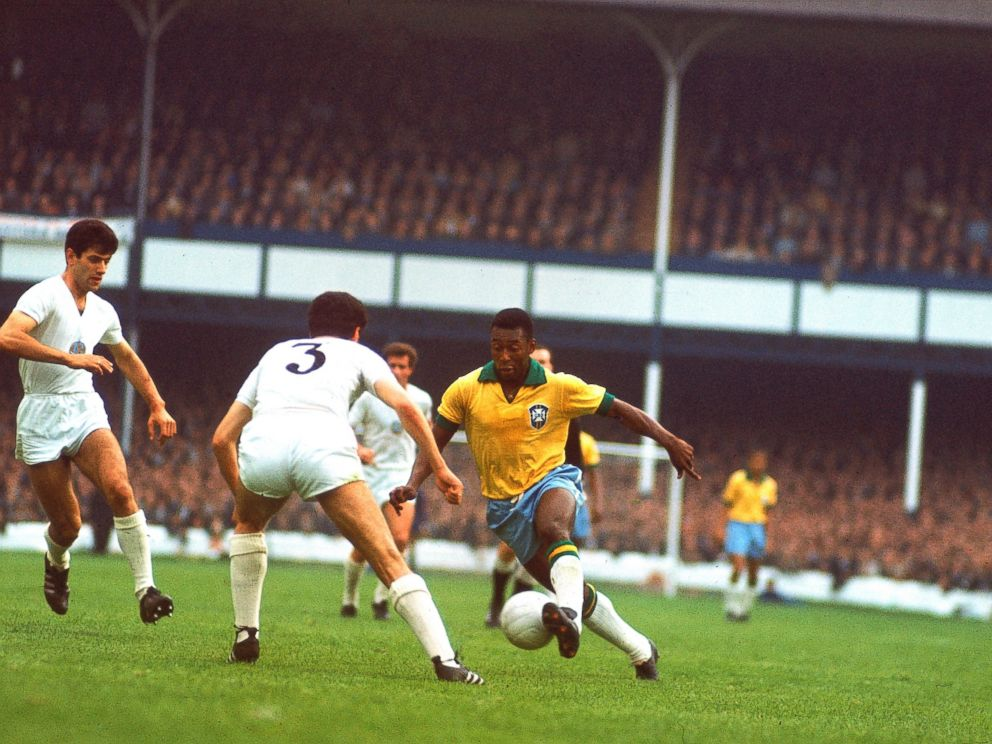 PHOTO: Brazilian soccer (football) star Pele (center, in yellow jersey) controls the ball for Brazil at Goodison Park during a match against Hungary in the 1966 World Cup tournament, Liverpool, England, in this July 15, 1966, file photo.