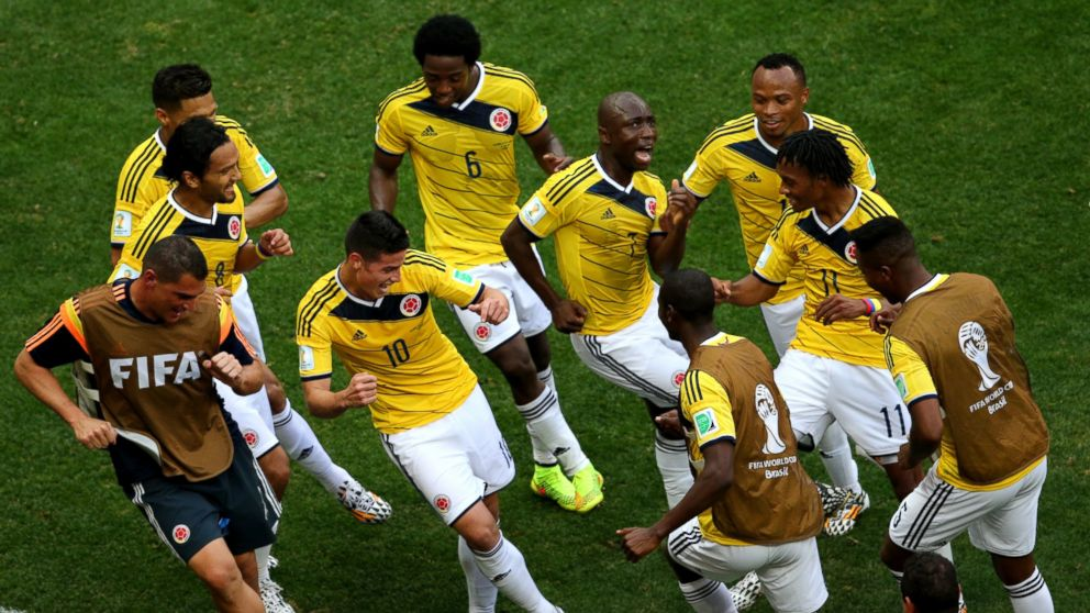 PHOTO: James Rodriguez #10 of Colombia celebrates by dancing with teammates after scoring his teams first goal during the 2014 FIFA World Cup Brazil Group C match between Colombia and Cote DIvoire at Estadio Nacional on June 19, 2014.