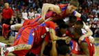PHOTO: The Dayton Flyers celebrate after defeating the Ohio State Buckeyes