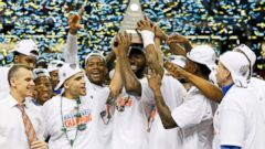 PHOTO: The Florida Gators celebrate with the trophy after their 61 to 60 win over the Kentucky Wildcats in the Championship game of the 2014 Mens SEC Basketball Tournament at Georgia Dome, March 16, 2014, in Atlanta.