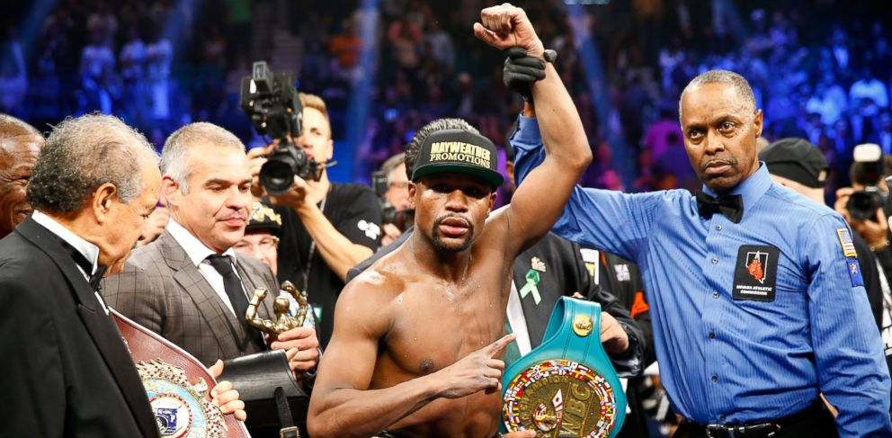 PHOTO: Floyd Mayweather Jr. celebrates the unanimous decision victory during the welterweight unification championship bout on May 2, 2015 at MGM Grand Garden Arena in Las Vegas.