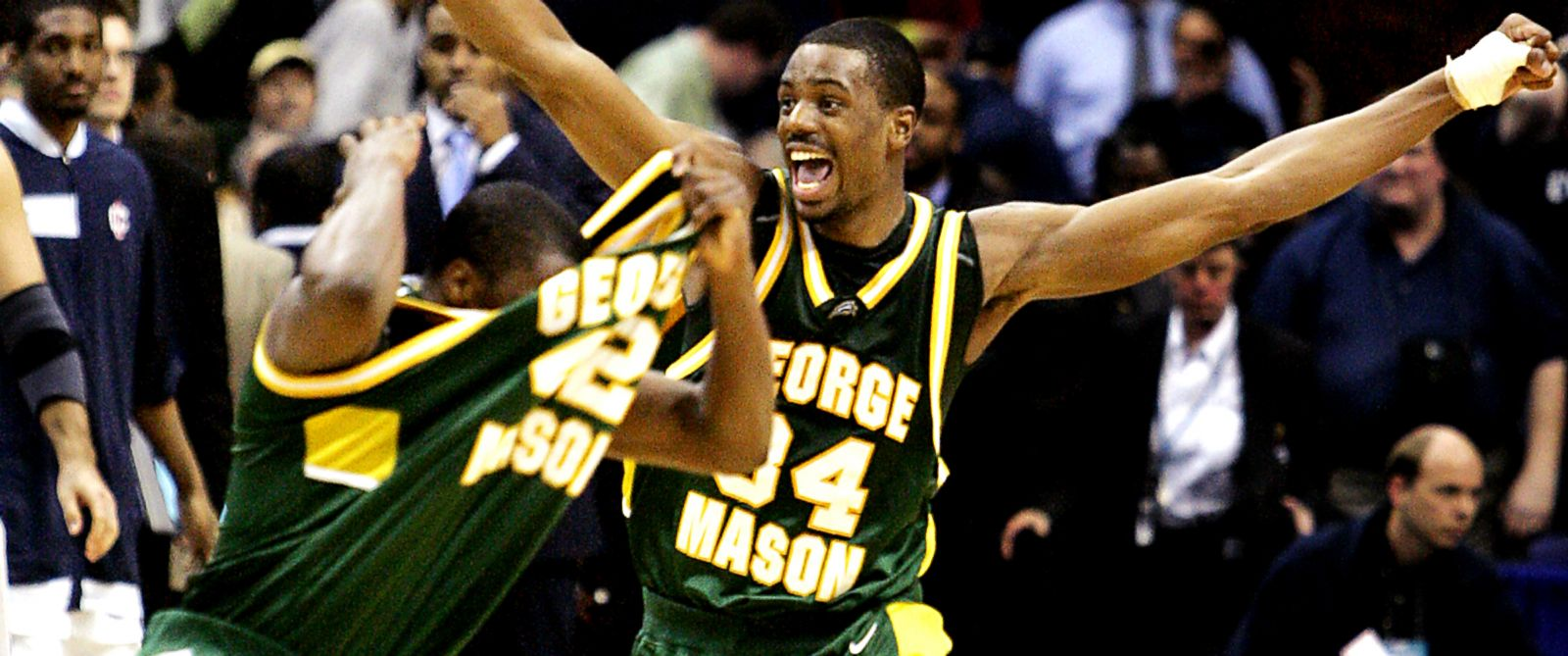 PHOTO: After beating Connecticut in overtime, George Mason teammates celebrate after defeating No. 1 seed UCONN, 86-84 in Washington during the NCAA tournament, March 26, 2006.