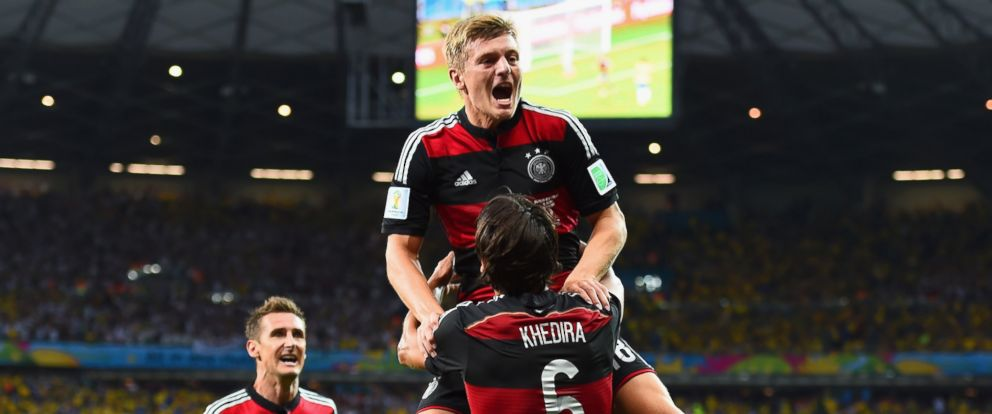 PHOTO: Toni Kroos of Germany celebrates scoring his teams third goal with teammates Miroslav Klose, left, and Sami Khedira during the Semi Final match between Brazil and Germany at Estadio Mineirao on July 8, 2014 in Belo Horizonte, Brazil.