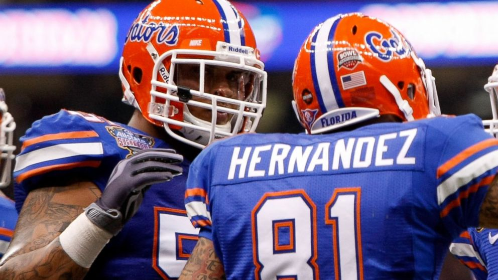 PHOTO: Aaron Hernandez #81 of the Florida Gators celebrates with his teammate Mike Pouncey #55 after scoring a touchdown in the first quarter against the Cincinnati Bearcats at the Louisana Superdome, Jan. 1, 2010, in New Orleans.