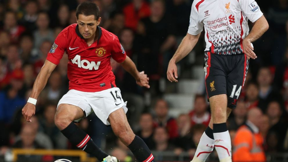 "PHOTO: Javier ""Chicharito"" Hernandez of Manchester United in action with Jordan Henderson of Liverpool during the Capital One Cup Third Round match between Manchester United and Liverpool in this Sept. 25, 2013, file photo in Manchester, England."