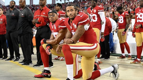 PHOTO:Colin Kaepernick, #7, and Eric Reid, #35, of the San Francisco 49ers kneel in protest during the national anthem prior to playing the Los Angeles Rams in their NFL game, Sept. 12, 2016, in Santa Clara, California.