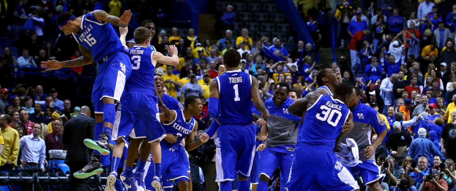 PHOTO: The Kentucky Wildcats celebrate defeating the Wichita State Shockers 78 to 76 during the third round of the 2014 NCAA Mens Basketball Tournament at Scottrade Center on March 23, 2014 in St Louis.