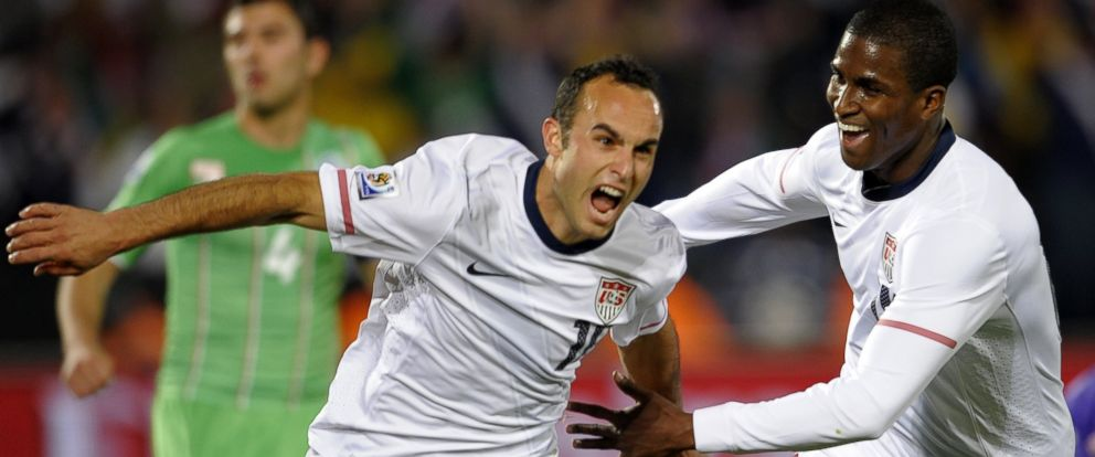 PHOTO: US midfielder Landon Donovan celebrates his goal with teammate striker Edson Buddle during the Group C, first round, 2010 World Cup football match USA vs. Algeria, June 23, 2010.