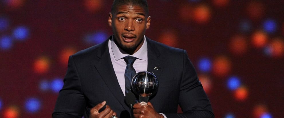 PHOTO: Michael Sam accepts the Arthur Ashe Courage Award onstage during the 2014 ESPYS