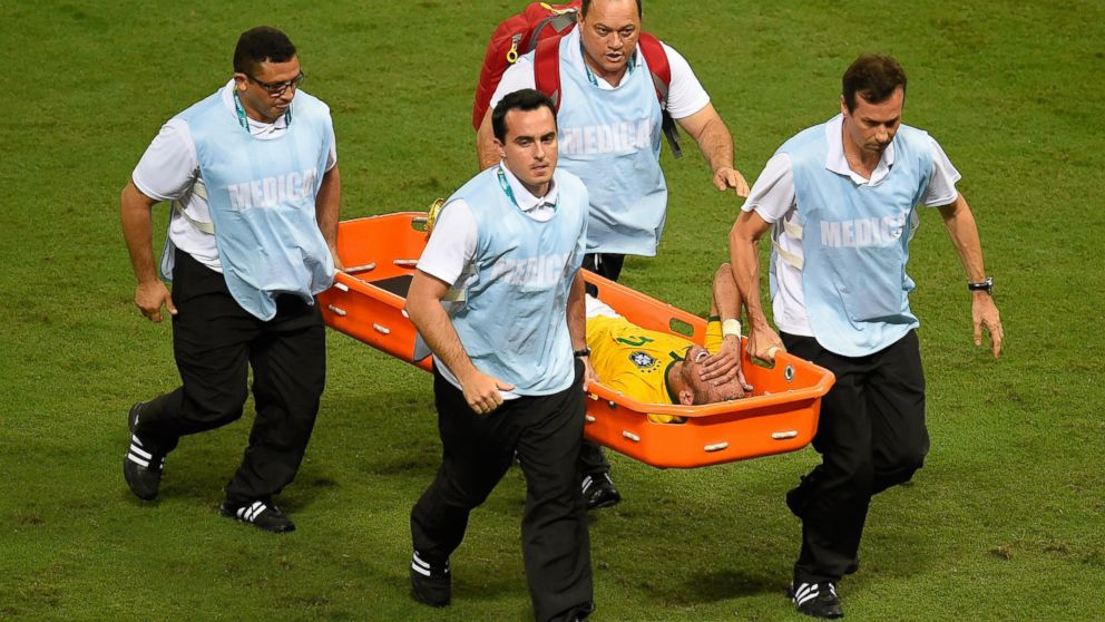 PHOTO: Brazils forward Neymar is carried on a stretcher after he was injured following a tackle during the quarter-final football match between Brazil and Colombia at the Castelao Stadium in Fortaleza during the 2014 FIFA World Cup on July 4, 2014.