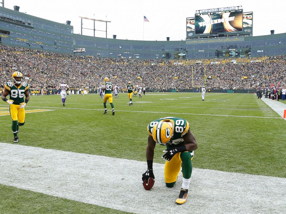 PHOTO: James Jones #89 of the Green Bay Packers kneels to pray after making a touchdown reception against the Minnesota Vikings during the game at Lambeau Field, Dec. 2, 2012, in Green Bay, Wis.