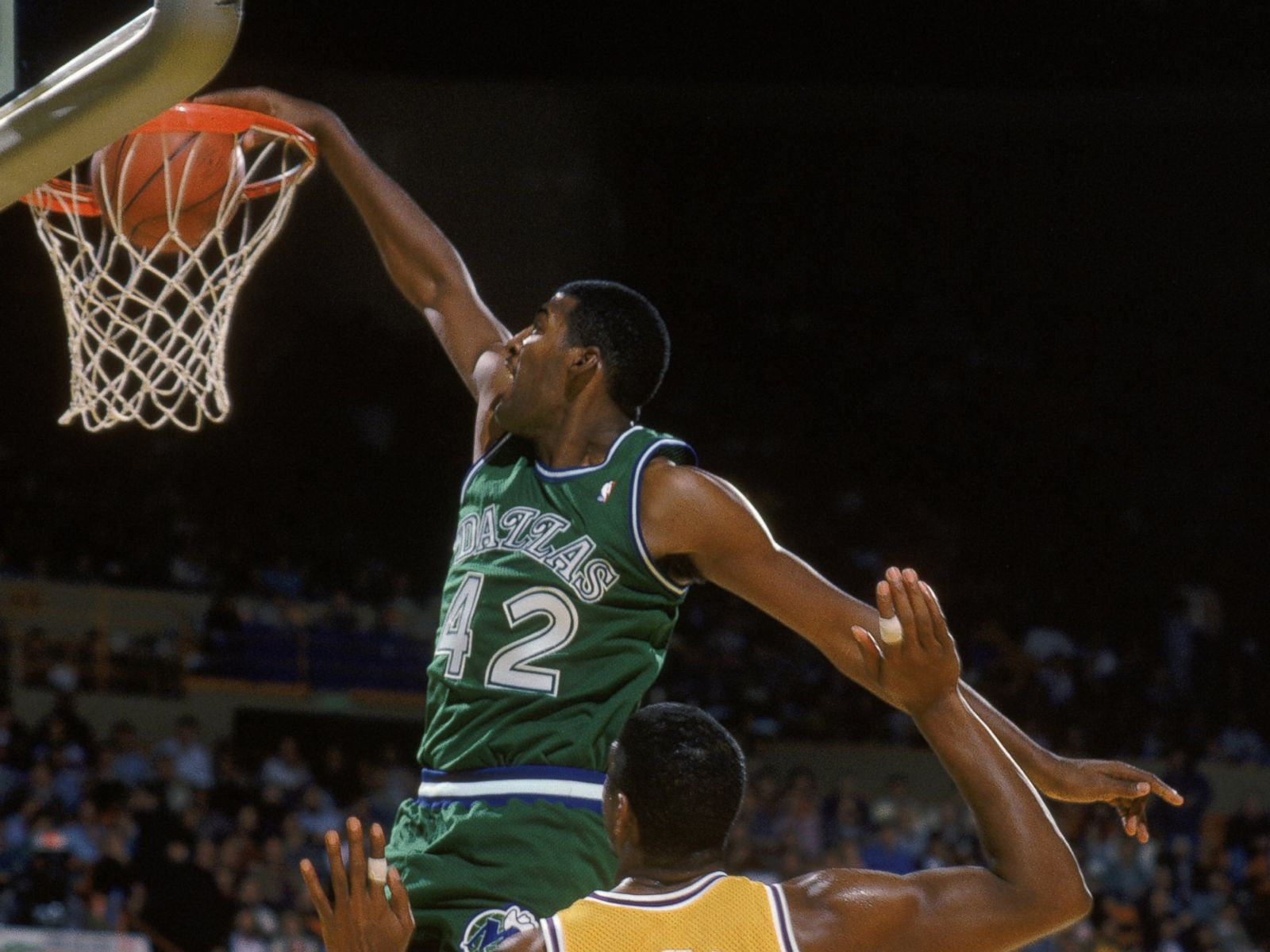 PHOTO Roy Tarpley 42 of the Dallas Mavericks dunks the ball past