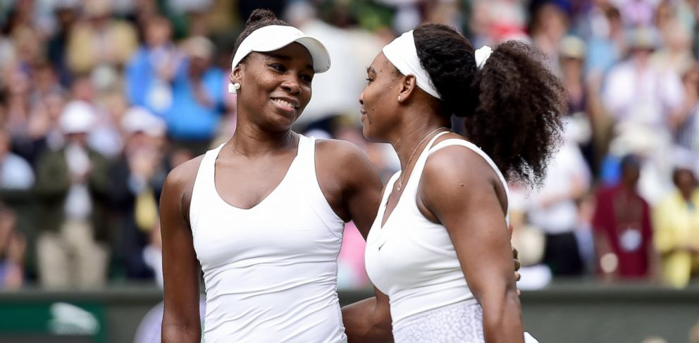 PHOTO: Venus Williams and Serena Williams, right, react after their match during day eight of the Wimbledon Lawn Tennis Championships at the All England Lawn Tennis and Croquet Club, July 6, 2015, in London.