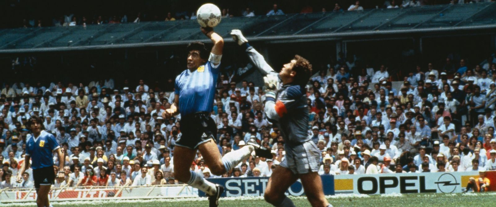 "PHOTO: Argentinas Diego Maradona scores with his ""Hand of God,"" past England goalkeeper Peter Shilton on June 22, 1986 in Mexico."