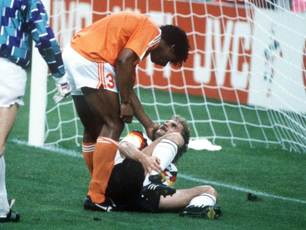 PHOTO: West Germanys Rudi Voeller, right, clashes with Hollands Frank Rijkaard, center, as Dutch goalkeeper Hans Van Breukelen, left, watches on June 24, 1990 in Milan, Italy. Rijkaard later spat on Voeller as they left the field after being sent off.