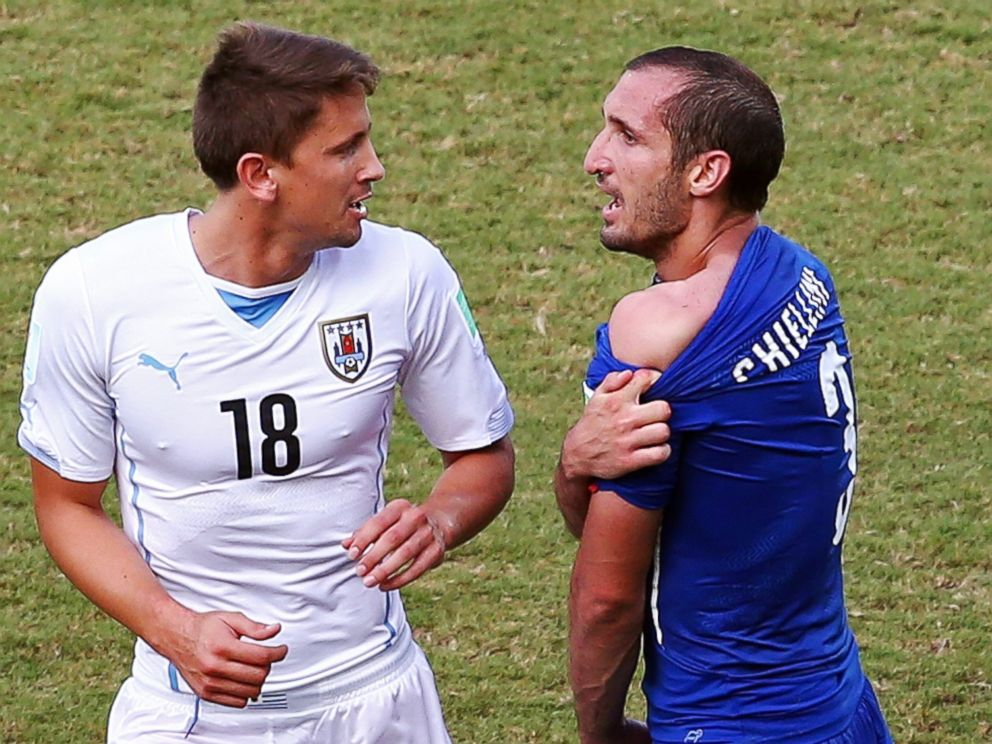 PHOTO: Giorgio Chiellini of Italy pulls down his shirt after a clash with Luis Suarez of Uruguay (not pictured) as Gaston Ramirez of Uruguay looks on during the match between Italy and Uruguay at Estadio das Dunas on June 24, 2014 in Natal, Brazil. The Disciplinary Committee took into account all the factors of the case and the degree of Mr</p>                           <div class=