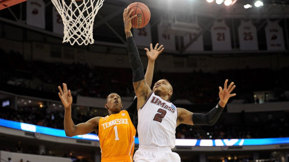 PHOTO: Derrick Gordon, right, of the Massachusetts Minutemen goes up for a shot against Josh Richardson of the Tennessee Volunteers in the second round of the 2014 NCAA Mens Basketball Tournament at PNC Arena on March 21, 2014.