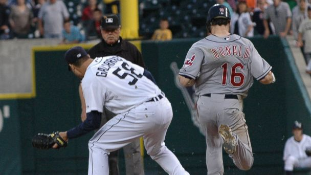 PHOTO: In this file photo, pitcher Armando Galarraga, left, of the Detroit Tigers covers first base as Jason Donald, right, of the Cleveland Indians steps on the bag while umpire Jim Joyce, background center, watches on Jun. 2, 2010 in Detroit, Mich.