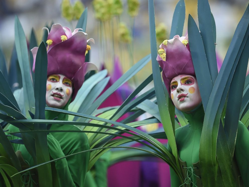 PHOTO: People dressed as flowers take part in the opening ceremony of the 2014 FIFA football World Cup at the Corinthians Arena in Sao Paulo on June 12, 2014.