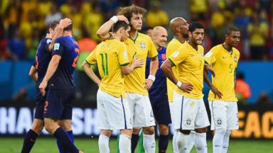 PHOTO: David Luiz consoles Oscar of Brazil as Hulk and Fernandinho of Brazil look on after a 3-0 defeat to the Netherlands during the 2014 FIFA World Cup Brazil Third Place Playoff match at Estadio Nacional on July 12, 2014 in Brasilia, Brazil.