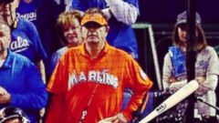 Laurence Leavy, known as Marlins Man, watches Game 1 of the 2014 World Series, Oct. 21, 2014 in Kansas City, Mo.