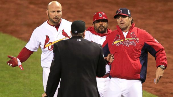 PHOTO: Mike Matheny of the St. Louis Cardinals argues a call with home plate umpire, Paul Emmel, during Game Four of the 2013 World Series against the Boston Red Sox at Busch Stadium in St. Louis, Oct. 27, 2013.