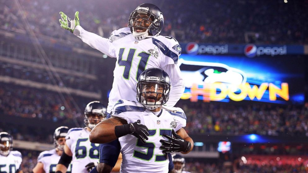 PHOTO: Seattle Seahawks outside linebacker Malcolm Smith (53) and cornerback Byron Maxwell (41) celebrate a touchdown during the first half against the Denver Broncos in Super Bowl XLVIII at MetLife Stadium, Feb. 2, 2014.