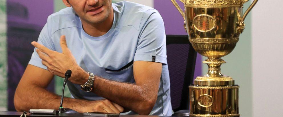 Switzerlands Roger Federer speaks next to the Mens Singles tennis trophy he won on Sunday during a photo call at The All England Lawn Tennis and Croquet Club, Wimbledon, England, Monday July 17, 2017. Federers eighth Wimbledon title pushed him ba