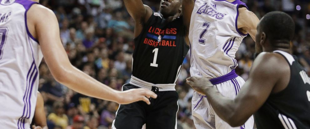 FILE - In this July 7, 2017, file photo, Los Angeles Lakers Lonzo Ball blocks a shot by Los Angeles Clippers Jawun Evans during the first half of an NBA summer league basketball game, in Las Vegas. In the midst of the worst stretch in franchise his