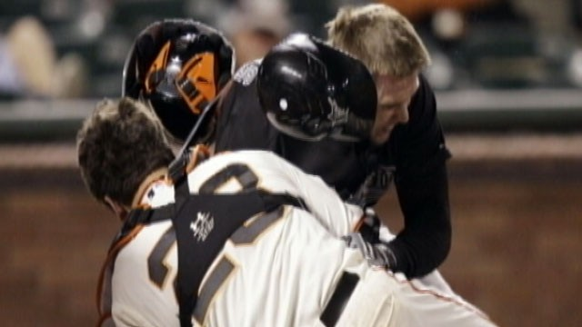 PHOTO: San Francisco Giants catcher Buster Posey suffered a leg fracture and torn ligaments when Florida's Scott Cousins barreled into him at home plate in the 12th inning of the Marlins-Giants game May 25, 2011.
