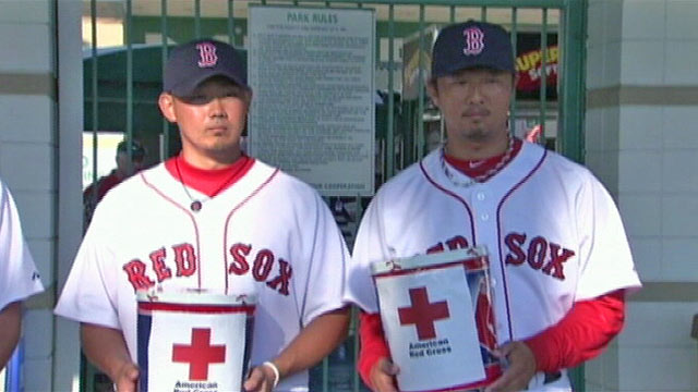 PHOTO: Seen here former player Hideki Okajima, right, and active roster Boston Red Sox player Daisuke Matsuzaka.