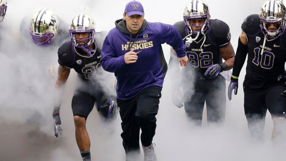 PHOTO: In this Nov. 29, 2013 file photo, Washington head coach Steve Sarkisian runs onto the field before a game against Washington State in Seattle.