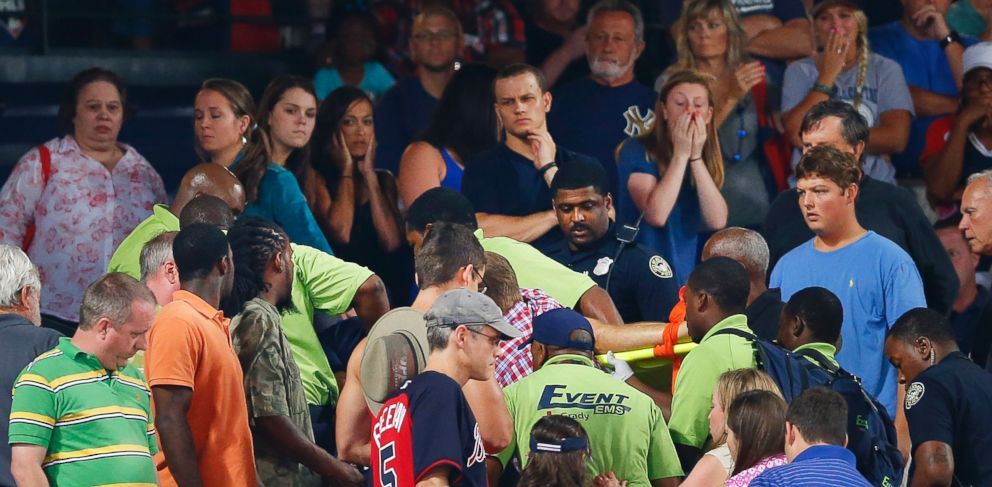PHOTO: Rescue workers carry an injured fan from the stands at Turner Field during a baseball game between Atlanta Braves and New York Yankees, Aug. 29, 2015, in Atlanta.