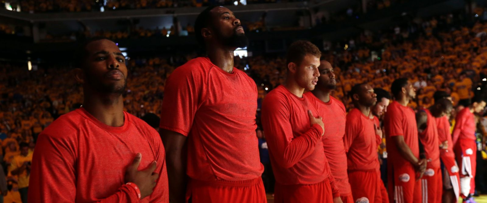 PHOTO: Members of the Los Angeles Clippers listen to the national anthem before Game 4 of an opening-round NBA basketball playoff series against the Golden State Warriors on Sunday, April 27, 2014, in Oakland, Calif.