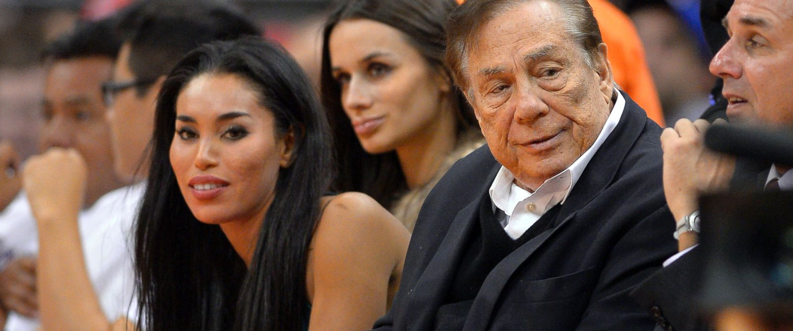 PHOTO: In this photo taken on Friday, Oct. 25, 2013, Los Angeles Clippers owner Donald Sterling, right, and V. Stiviano, left, watch the Clippers play the Sacramento Kings in Los Angeles.