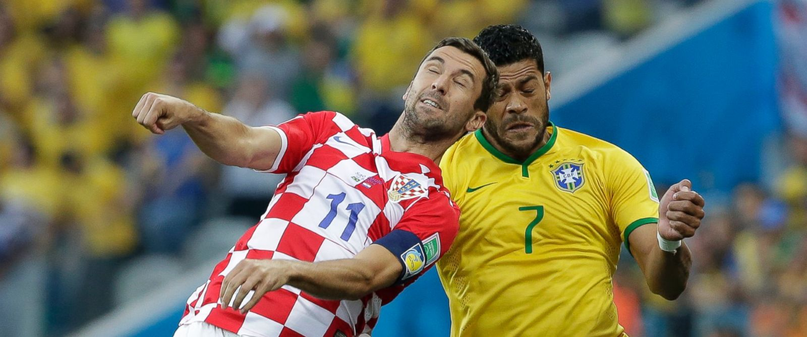 PHOTO: Croatias Darijo Srna, left, and Brazils Hulk battle for the ball during the group A World Cup soccer match between Brazil and Croatia, the opening game of the tournament, in the Itaquerao Stadium in Sao Paulo, Brazil, June 12, 2014.