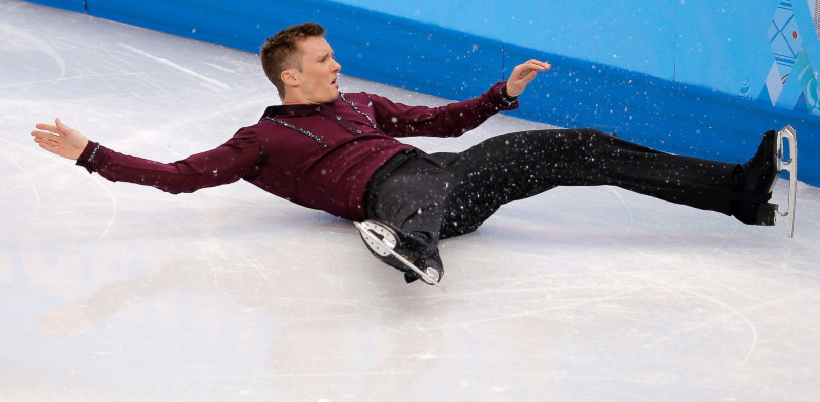 PHOTO: Jeremy Abbott of the United States falls as he competes in the mens short program figure skating competition