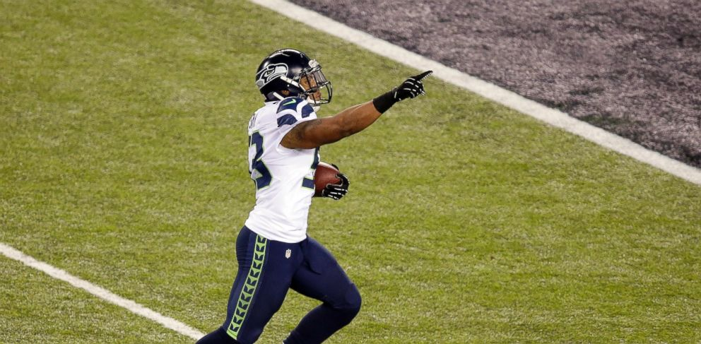 PHOTO: Seattle Seahawks Malcolm Smith (53) runs back an interception for a touchdown during the first half of the NFL Super Bowl XLVIII football game against the Denver Broncos on Feb. 2, 2014, in East Rutherford, N.J.