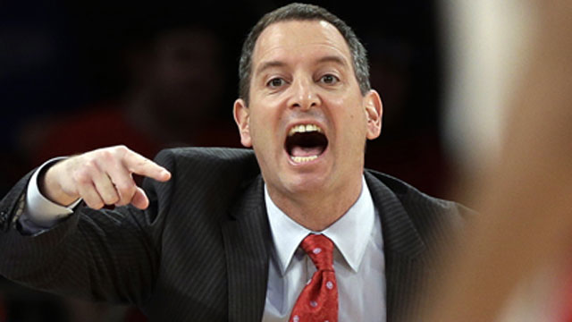 PHOTO: In this March 12, 2013, file photo, Rutgers coach Mike Rice yells out to his team during a